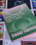 Sweet Harmony booklet and coloured poster in the background