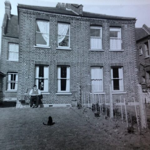 Black and white image of the back of a Warner half house in Hitcham Road