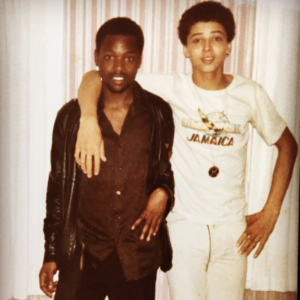 Image of a young MC Navigator with his arm around a friend's shoulders
