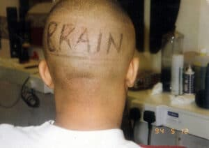 The word BRAIN shaved into the back of Bizzy B's head